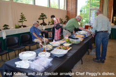 Paul Kulesa and Jay Sinclair Arrange Chef Peggy's Dishes